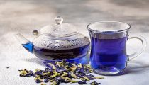 Organic blue tea Anchan, Clitoria, Butterfly Pea in glass cup an